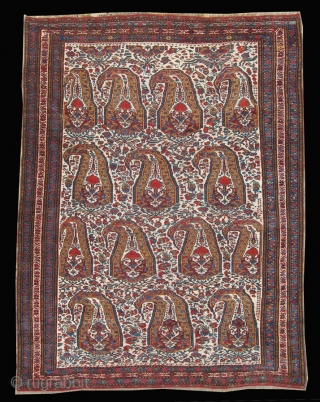 "A beautiful shawl-inspired Khamseh boteh design rug with crisp colors against an ivory ground. Interesting floral filler between the botehs. Bottom 1"" expertly restored and very small scattered re-knotting in field."