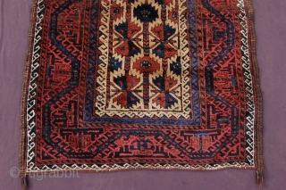 "Meaty camelground tribal Baluch rug 134 x 93 cm  (4ft 10"" x 3ft 1"") last quarter 19th century. All natural dyestuffs, colours: red, dark blue, blueish green, camel, brown, dark brown  ..."
