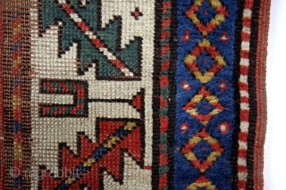 Caucasus, Kuba area, early 20th century.  170 x 100 Cm. Wool on wool.  Gracefully fading away in time.  Zoroastic symbols in the border.  'Barber pole' stripes with swastica's, solar symbols.