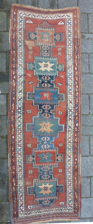 """Antique NW-Persian/ Caucasian runner, 312  x 105 cm., 10'3"""" x 3'5"""" on woolen ground. With some wear and with all natural dyes. One older repair ( see pict. 3). Washed."""