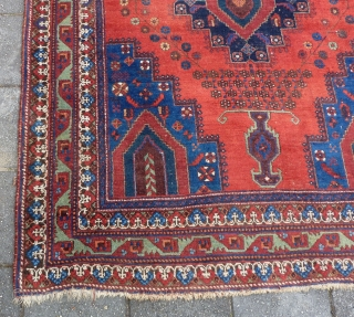 "Afshar rug, ca. 1920, 211  x 161 cm., 6'11"" x 5'3"". In general good pile with original sides and endings. Corroded browns, a bit of lower pile at the central part  ..."