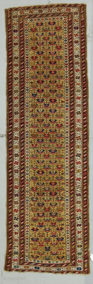 3' x 10' E. Caucasian rug, clear yellow ground with soft purple. Flat to the top, end slightly reduced, very small patch.