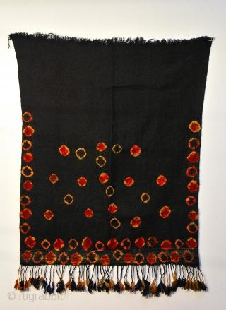 Tunisian Berber woman's veil. Dark indigo almost black with tie dye motifs in orange, blood red, and indigo circa 1960  27 x 32.5 inches including fringe