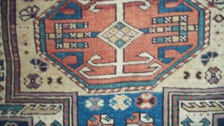 "#7241 Shirvan Antique Caucasian Rug This circa 1875 keyhole design Shirvan antique Oriental Rug measures 3'7"" X 5'3"".   It has a dark blue ground with ivory keyhole center motif.  ..."