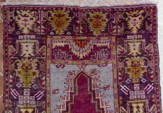 Çamardı/Niğde Prayer rug, Maden region, Central Anatolian. 5.3ft x 3.4ft (163 x 105 cm.) Circa 1930 Atractive rug with magenta red prayer niche on a pale blue ground. Border design with large palmettes  ...