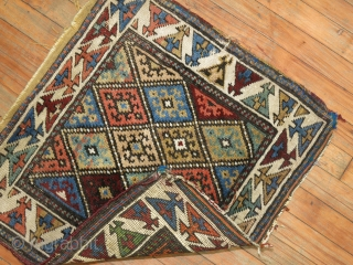 Antique Kurdish Jaff.  Measures 2'x2'1''.  Super cool colors and border.  A little dinged up an sides and ends.