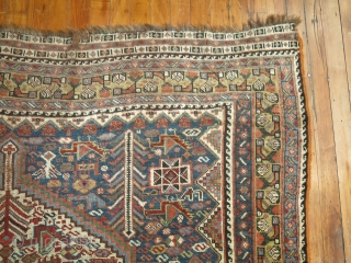 Antique Shiraz 5'x9'3''.  Low areas.  Decorative colors.