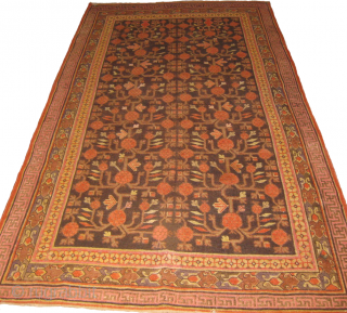 An old Pomegranate Samarkand/ Khotan carpet measuring 9.7 x 4.11 ft, has few small repaired areas.