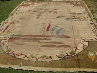 An old Art Deco rug needs repair measuring 15.2 x 11.8 feet.