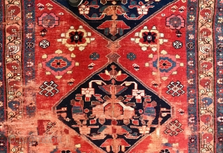 Old North west Persian rug with Minakhani references. Fabulous colors. Sporadic condition issues which shouldn't bother serious collectors. Or a smart decorator. Or a regular person.