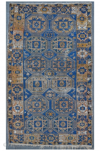 East Caucasian carpet with twelve Oktagon medallions and beautiful Kufi Border, possibly Konagkend, 209 x 120 cm, even low pile