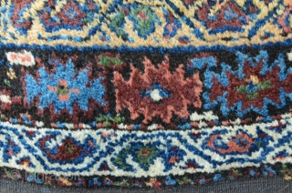 Kordi 244 x 148 cm, meaty floor with shiny colors. As found condition with some damages on the lower end.