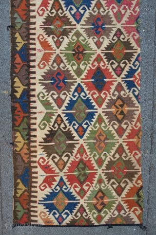 """Antique Anatolian kilim fragment with """"Elibelinde"""" pattern, deep saturated colors, 305 x 76 cm"""