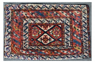 Kurdish Bagface with brilliant colors and meaty floor. 87 x 55 cm, several old restorations at the main bordure.