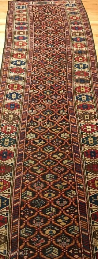 Daghestan Runner.  Circa 1850.  Stunning Caucasian runner exhibiting curvature to field design and unequal minor borders: a hallmark of tribal weaving. Daghestan border.   Some field motifs appearing three  ...