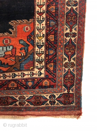 Afshar Vase Rug. Last Quarter 19th Century. Classic vase design. On the dark indigo field sit two opposing flower filled vases at top and bottom. Great condition. Original four sides. Kilim ends.  ...