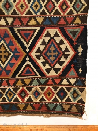 Shirvan Kilim. 2nd Half 19th Century. A very colorful and finely woven early kilim. 6 x 5 large hexagonal rows are separated by cross tipped triangles. 7 Horizontal bands contain stepped diamonds.  ...