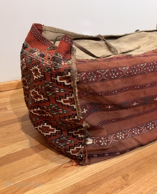 Antique Yomud Chuval. 19th Century. It is rare to find complete storage bags as many have been dismembered due to harsh conditions of seasonal migration. Sides feature a stepped hooked gul. Rear  ...