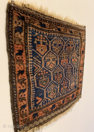 "Antique Timuri Baluch Bagface. 3rd Quarter 19th Century. Dokhtar-I Ghazi honey comb design. Saturated colors including a nice green. Very good condition. Original four sides and no repairs. 6 colors. 1'8"" x  ..."