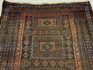 Antique Maadan Baluch Long Rug. Northeast Persia, Khorasan. This finely woven brown field offers a captivating inner border of rams. The central tribal design patterns are seen enclosed by 9 intricate borders.  ...