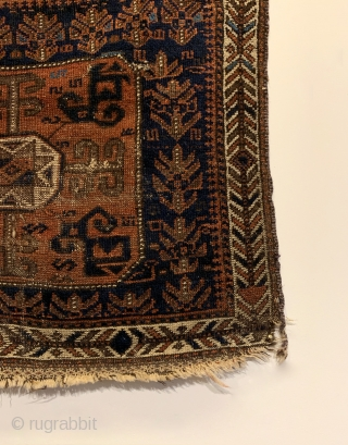 Antique Baluch Bagface. North East Persia. 2nd Half 19th Century. Shrubs and S design on blue field surround Tukoman like Gol with quartered dragon elements. Interesting white ground border. Original condition. Nice  ...