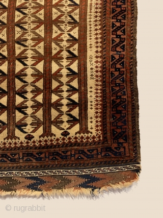 Rare Antique Baluch Prayer Rug. Circa Early. Powerful indigo S dragons inside hand panels and a fine trefoil border frame three and a half tree totems on rare ivory ground field. Note: In  ...