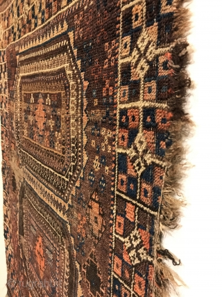 Antique Baluch Rug.  Rare design, Turkoman influenced. Two siamese turreted gols float on saturated brown field. Stepped diamonds with abstract crosses fill center. Great condition considering age. Selvage loss to right side.  ...