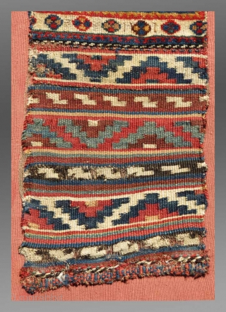 """Luri 'Chanteh' (personal bag), S. Persia, 19th C., 10"""" x 2' 3"""" (excluding the mount)  A fragmented but beautiful example of Luri weaving, mounted (sewn onto a rose colored cotton cloth and stretched  ..."""