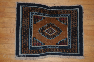 Small sitting mat. Nice graphic medallion. Tibet Late 19th Century 24x 30 inches