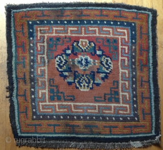 Sitting Carpet. Archaic composition with bold border structure. Goat hair foundation. Vegetal dyed wool pile. 32 x 32 inches Village weaving 19th century TIbet  * conditions: some minor discoloration. Requires minor restoration....Broken selvedge (visible on lower left side).two broken  ...