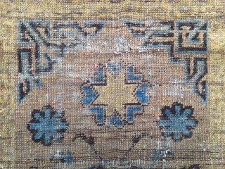 khotan oasis, small size khotan rug with an unusual center medallion, made in the early style with some early partly faded artificial dyes. worn. last quarter 19th century, 125 x 75 cm,  ...