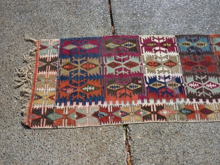 "Anatolian kilim-half  which someone cut in half (probably for display purposes--could be rejoined fairly easily).  Some of the dies are ""hot"" transitional colors, but still a piece with great workmanship  ..."