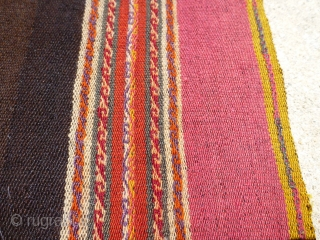 Antique Aymara or Quechua manta textile from Peru or Bolivia. All wool construction with beautiful colors. Beautiful natural brown abrashed field.  In good condition for its age. Some minor edge and end damage.  ...