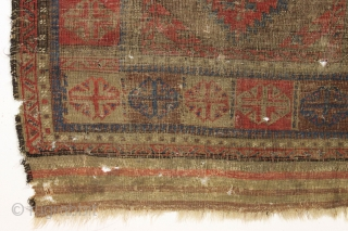 Antique baluch. Interesting large scale design. Nice reds. If wear is age then this one is ancient. Many many tiny moth nibbles and tiny holes, and hard to tell the front from  ...
