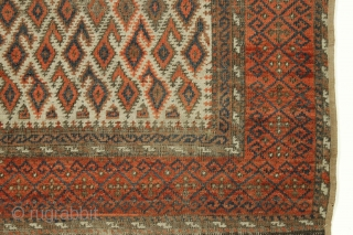 """Antique ivory ground baluch rug. Unusual border and ivory, not light camel ground. Looks like all good colors but very very dirty. Rough condition as shown. 19th c. 3' x 4' 11""""  ..."""