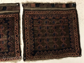 Antique original pair of Baluch bagfaces. Interesting and unusual horizontal use of Baluch tree motifs. Overall low pile with scattered heavy brown oxidation. Remnant rough selvages, rewrapped on one bagface. Original closure  ...