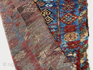 Early east Anatolian Kurdish pile rug fragment. Splendid natural colors with saturation rarely found outside these beautiful weavings. Good fleecy pile with scattered wear, holes, tears and brown oxidation. Edges unraveling. Remnant  ...