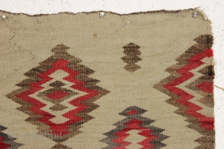 """old small navajo rug with an interesting design and overall fair condition. """"as found"""", dirty but still floppy handle and I see a small hole or two barely showing. No color run.  ..."""