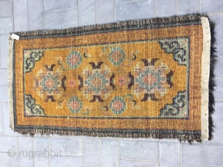 """Tibet rug, yellow background with nice group flowers pattern, Lucky clouds  in the four corner. Good age and condition. Size 160*88cm(62*34""""). Wool warp and weft"""