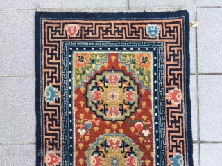 "Tibet rug, red background with three group flower pattern, around with Buddha hand veins. Good age and condition. Size 148*72cm(58*28"")"