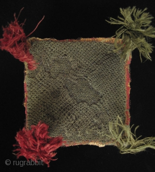 A colorful four-cornered hat from the Huari culture of the Highlands of Peru. Made of camelid wool yarns and natural dyes, it has a mesh screen on the top to contain the  ...