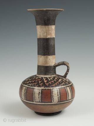 """Small jar, Inca, Peru, Earthenware, 6.5"""" (16.5 cm) high, 1470-1550 A.D. An unusual globular terracotta jar with a tall neck, flared top and loop handle, painted on the shoulder with a stylized  ..."""