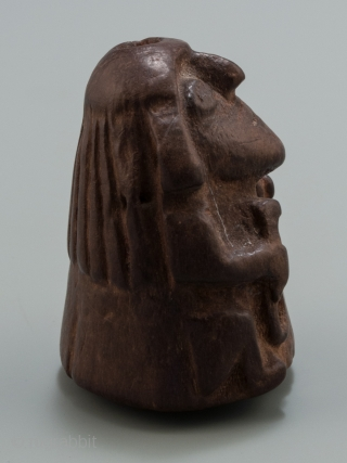 """Stargazer shaman lime container, Huari, Peru. Wood, 1.75"""" (4.5 cm) high. A.D. 700-1000.  This lime container depicts a 'stargazer' shaman holding the tools of his trade. Lime containers were personal items and a 'kill hole' was made  ..."""