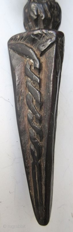 Antique Tibetan Wooden Phurba  Antique Tibetan wood carved phurba, a ritualistic Vajrayana Buddhist implement. Wrapped with colored cloth around the lotus handle. Phurbas often depict Nagas or snakes on the blade. Nagas are  ...