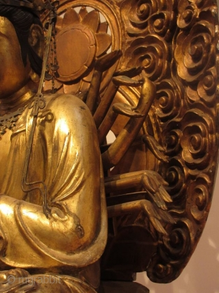 Antique Japanese 24 Armed Kannon Seated Bodhisattva   A large figure of 24 armed seated Kannon, gold gilt over wood carving of the bodhisattva of compassion, seated in meditation atop a lotus pedestal, two  ...