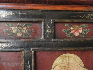 Rare 18th Century Tibetan Buddhist Painted Altar Cabinet  Rare Tibetan hand-painted lacquer altar cabinet. Original finish with patina. The front three panels depict three faces. The left face has red skin and green  ...