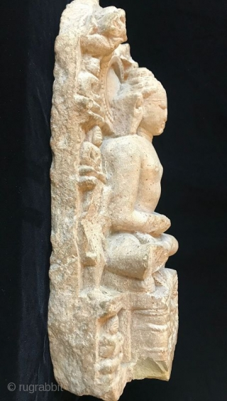 Antique Jain Sandstone Stele with a Jina  A rare Jain Indian sandstone Stele with a carved image of Buddha surrounded by his attendants from the Gujarat or Rajasthan regions. Seated figures of Jain  ...