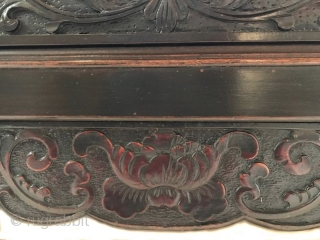 Antique Chinese Export Canopy Bed  A 19th century Chinese canopy lacquered bed of cypress and elmwood (ju-mu). The bed rail has a turned spindle gallery with a low relief carving of scrolling floral  ...