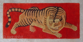 """No.R154 * Chinese Antique Tiger Rug ,Age: Early 20th Century.Size: 63x132cm(2'1""""x4'4"""").Origin: Baotou-Suiyuan. Shape: Rectangle. Background Color: Reds."""