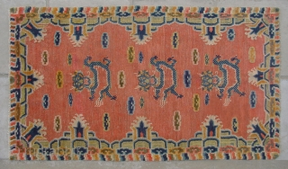 "No.CL043 * Tibetan ? Antique ""Dragon Face"" Rug.Age: 20th Century.Size: 94x162cm ( 3'1"" x 5'4"" ).Origin: Tibetan Shape: Rectangle  Background Color: Oranges"